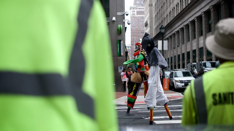 Marchers on stilts make their way through Center City during the annual Juneteenth parade on Saturday. (Bastiaan Slabbers for WHYY)
