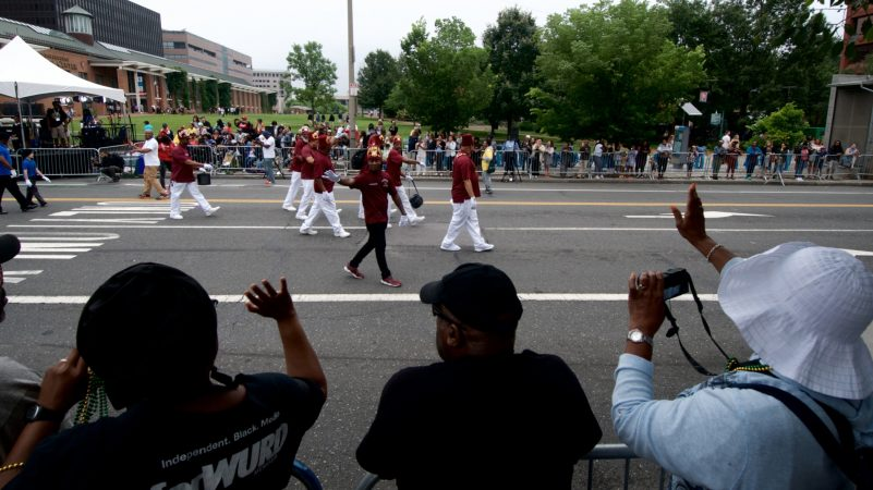Juneteenth celebrators line the route for the annual Juneteenth parade at Independence Mall, on Saturday. (Bastiaan Slabbers for WHYY)