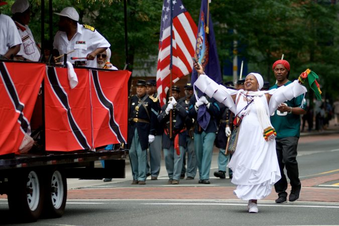 Marchers make their way through Center City during the annual Juneteenth parade on Saturday. (Bastiaan Slabbers for WHYY)