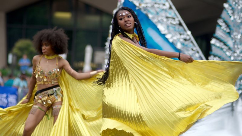 A Carnaval dance group from Trinidad performs during the Juneteenth Parade, in Center City, on Saturday. (Bastiaan Slabbers for WHYY)