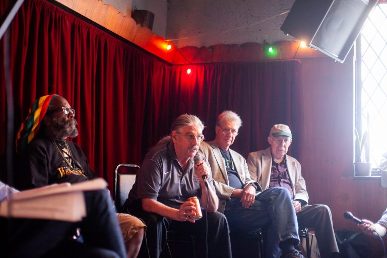 W.D. Ehrhart makes introductions at an event at Fergies's Pub in Center City to celebrate a recently released book of poetry by Vietnam veterans. (Brad Larrison for WHYY)