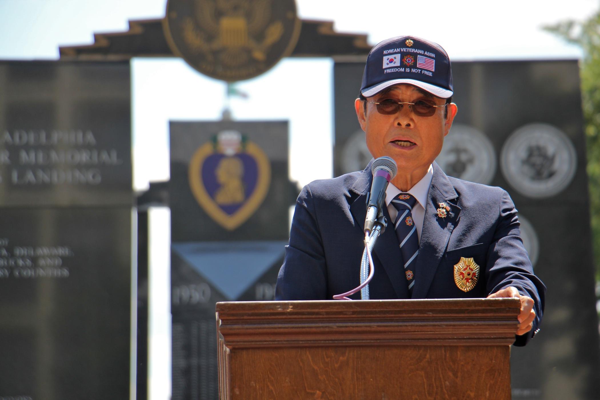 Oh Young Lee, president of the Korean Veterans Association of the Philadelphia Region, speaks at the Korean War Memorial Ceremony at Penn's Landing.