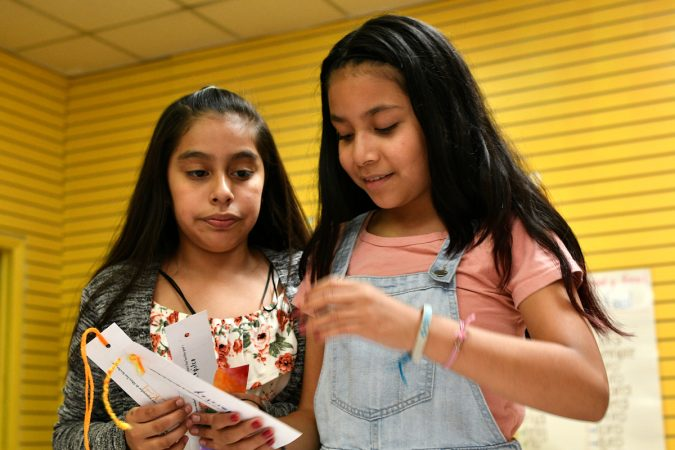 Alma, 11, and Yaretzy, 11, made bookmarks at Mighty Writers El Futuro in South Philadelphia. (Bastiaan Slabbers for WHYY)