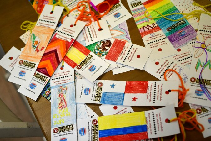 Bookmarks designed by Robert, 14, during a workshop at Mighty Writers El Futuro, to go with books send to immigrant families at the Berks County Detention Center. (Bastiaan Slabbers for WHYY)