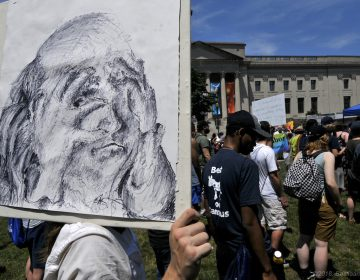 Ian Connito said drew this sign depicting a Benjamin Franklin feeling ashamed in an hour. Thousands came out to a protest immigrant family detention Saturday in Philadelphia. (Bastiaan Slabbers for WHYY)