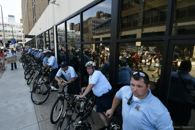 Protesters march through Center City, towards the ICE office on North 8th Street after a rally on Saturday. (Bastiaan Slabbers for WHYY)