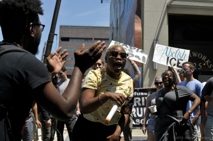 A group of protesters rally at the ICE field office on North 8th Street after a rally in Center City Saturday. (Bastiaan Slabbers for WHYY)