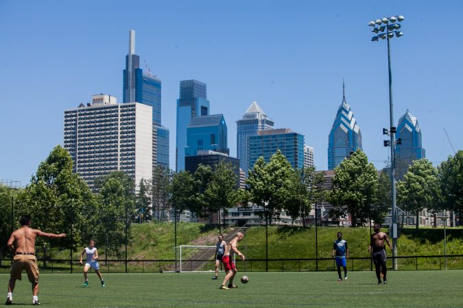 As the World Cup tournament began in Russia on June 14, 2018, some Philadelphians took advantage of a glorious day to play a game in Penn Park. (Brad Larrison for WHYY)