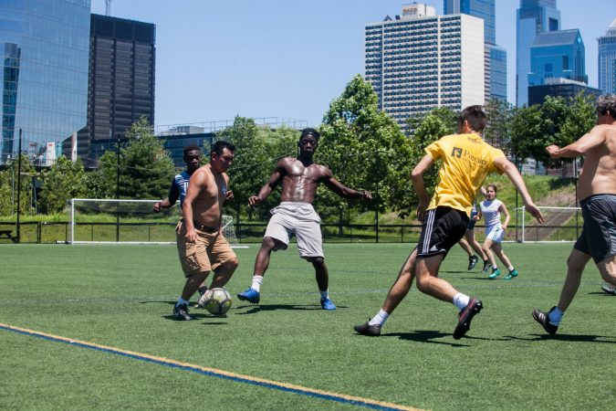 On the opening day of the World Cup in Russia on June 14, 2018, soccer players in Philadelphia enjoy a pickup game Thursday. (Brad Larrison for WHYY)