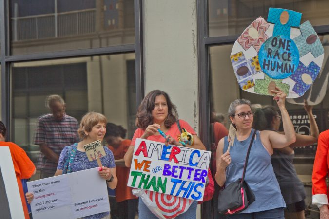 The ACLU and human rights groups rallied outside of the Center City offices of ICE in Philadelphia to protest the practice of separating children from their families. (Kimberly Paynter/WHYY)