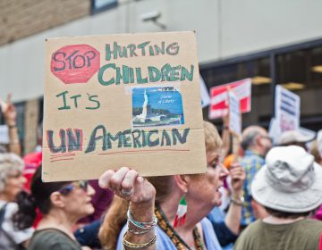 Abbie Hyde protests the practice of separating children from their families outside of the Center City offices of ICE in Philadelphia. (Kimberly Paynter/WHYY)