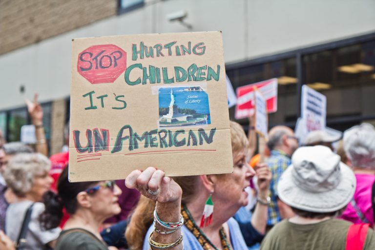 Abbie Hyde protests the practice of separating children from their families outside of theCenter City offices of ICE in Philadelphia. (Kimberly Paynter/WHYY)