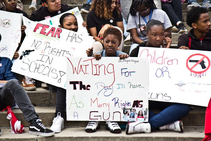 Niyaa Dupree, 16, (center) said she came to the rally against gun violence because of how firearms have affected her life. (Kimberly Paynter/WHYY)