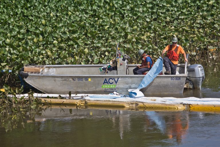 An environmental cleanup crew works to remove gasoline fuel from an ETP pipeline spill in Darby creek in Tinicum Township, Pennsylvania, last week. (Kimberly Paynter/WHYY)