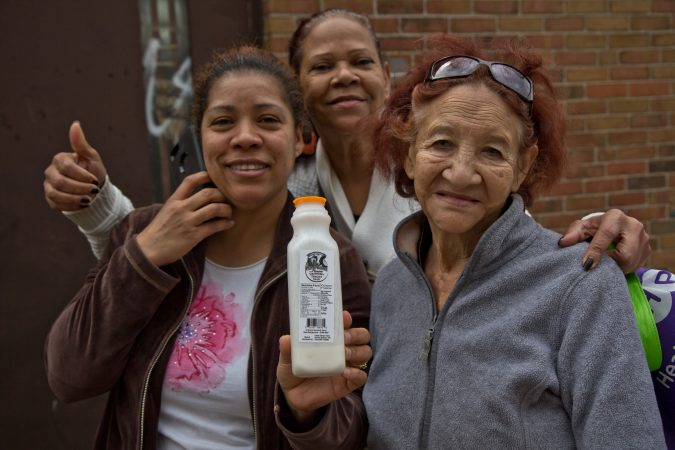 Philabundance clients said they love the drinkable yogurt they receive with their produce. (Kimberly Paynter/WHYY)