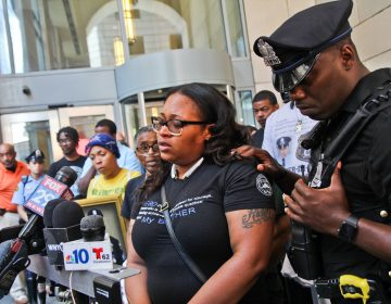 Officer Wilson's sister Shak'ra Wilson-Burroughs told the press she is disgusted with the plea deal for her brother's killers. (Kimberly Paynter/WHYY)