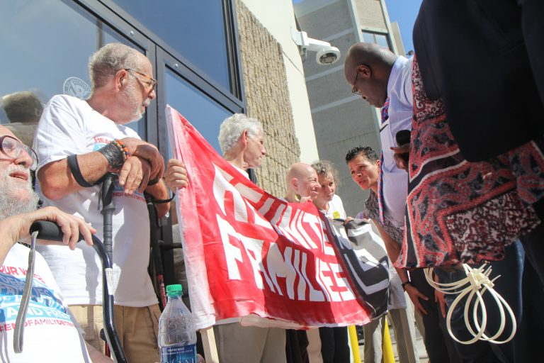 A senior citizen's group called The Old Farts were arrested in front of Philadelphia's ICE headquarters Friday morning in protest of the Trump administration's family separation policy. (Kimberly Paynter/WHYY)