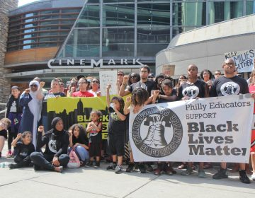 Demonstrators rally outside the Cinemark Theatres in Philadelphia. Last week, police were called on a black family who were unsatisfied with their movie experience. (Kimberly Paynter/WHYY)