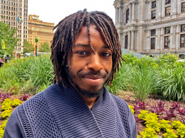 Tyquan McCray, 23, currently does deliveries for UberEats as he searches for a job that he feels is right for him. (Darryl Murphy/for WHYY)