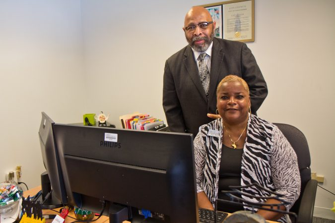 Michael Joynes is vice president of government and community relations at Philadelphia Works, and Nicki Woods is PA CareerLink administrator. (Kimberly Paynter/WHYY)