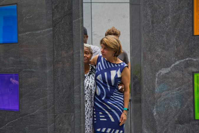 Maggie Adams Davis, (left) wife of Borbor Davis, and Nancy Winkler, (right) mother of Anne Bryan, remember their loved ones at the memorial. (Kimberly Paynter/WHYY)