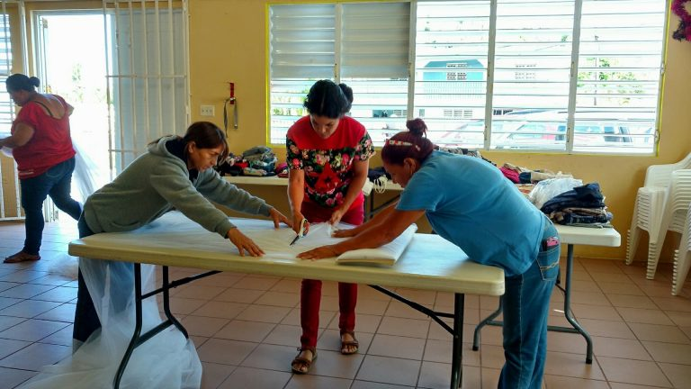 Rosita Canboh and community members in Barrio Las Vegas, Cayey, make mosquito nets for their neighborhood. Photo by Fernando Silva