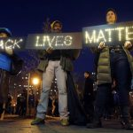 In this Dec. 4, 2014, file photo protesters rally in New York's Foley Square against a state grand jury's decision not to indict the police officer involved in the death of Eric Garner. (Jason DeCrow/AP Photo, File)