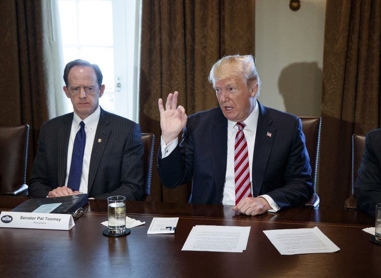 Sen. Pat Toomey, R-Pa., left, listens as President Donald Trump speaks during a meeting with lawmakers about trade policy in the Cabinet Room of the White House, Tuesday, Feb. 13, 2018, in Washington.