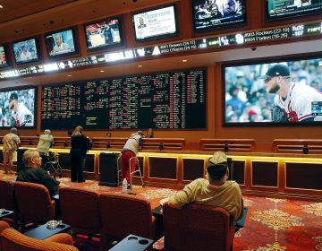 Bettors wager in the sports book at the South Point hotel and casino in Las Vegas. Now that the U.S. Supreme Court has cleared the way for states to legalize sports betting, Pennsylvania is reviewing applications from facilities that want to offer wagering on sports events. (John Locher/AP Photo)