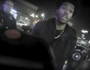 This Jan. 26, 2018 police body-camera footage released by Milwaukee Police Department shows NBA Bucks guard Sterling Brown as he talks to arresting police officers after being shot by a stun gun in a Walgreens parking lot in Milwaukee.