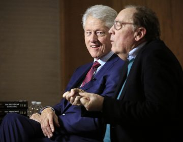 In this file photo, former President Bill Clinton listens as author James Patterson speaks during an interview about their new novel,