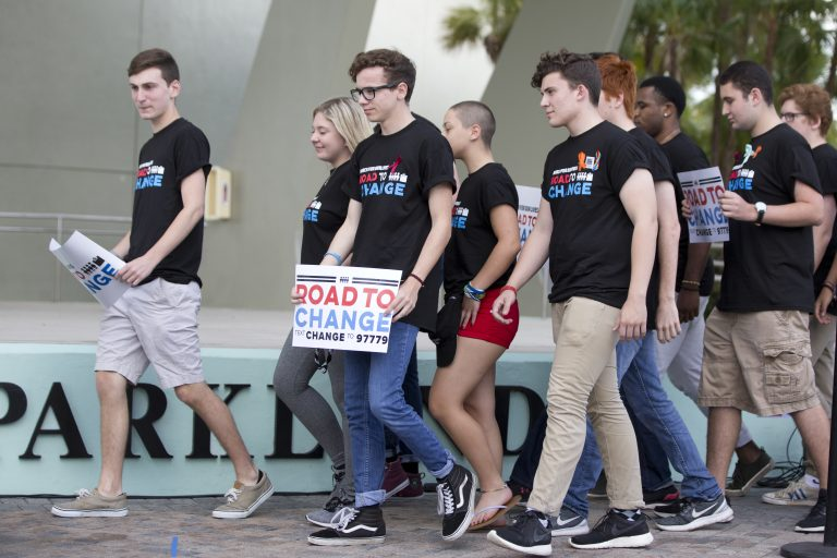 A group of Marjory Stoneman Douglas High School students arrive for a news conference, Monday, June 4, 2018, in Parkland, Fla. A day after graduating from high school, the group of Florida school shooting survivors has announced a multistate bus tour to