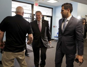 U.S. Sen. Bob Menendez is greeted by a poll worker as he arrives at the Harrison Community Center to cast his vote in the New Jersey primary election Tuesday, June 5, 2018, in Harrison, N.J. (Julio Cortez/AP Photo)