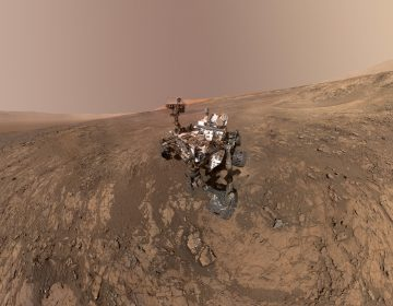 This composite image made from a series of Jan. 23, 2018 photos shows a self-portrait of NASA's Curiosity Mars rover on Vera Rubin Ridge. On Thursday, June 7, 2018, scientists said the rover found potential building blocks of life in an ancient lakebed and confirmed seasonal increases in atmospheric methane. The rover's arm which held the camera was positioned out of each of the dozens of shots which make up the mosaic. (NASA/JPL-Caltech/MSSS via AP)