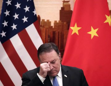 U.S. Secretary of State Mike Pompeo rubs his forehead during a joint press conference with Chinese Foreign Minister Wang Yi at the Great Hall of the People in Beijing, Thursday, June 14, 2018. (Andy Wong/AP Photo)