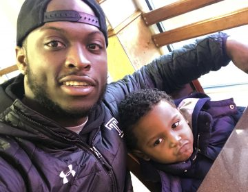 In this Feb. 10, 2018 photo, former Temple running back David Hood takes a selfie with his son, David IV in Mays Landing, N.J. Hood, who was Temple's leading rusher last season, was one of four Owls players parenting young children in 2017. Hood, 21, has moved on from football, graduating from Temple and leaving a year of football eligibility behind after sustaining a concussion this past spring. He has decided to focus solely on a promising career as a rapper. (David Hood via AP)