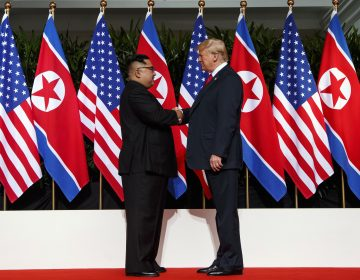 In this June 12, 2018, file photo, North Korean leader Kim Jong Un and U.S. President Donald Trump shake hands prior to their meeting on Sentosa Island in Singapore. (Evan Vucci/AP Photo, File)