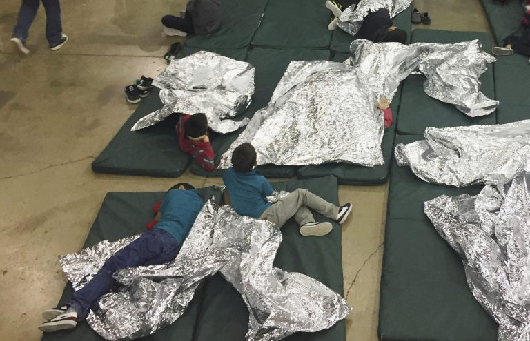 In this photo provided by U.S. Customs and Border Protection, people who've been taken into custody related to cases of illegal entry into the United States, rest in one of the cages at a facility in McAllen, Texas, Sunday, June 17, 2018.