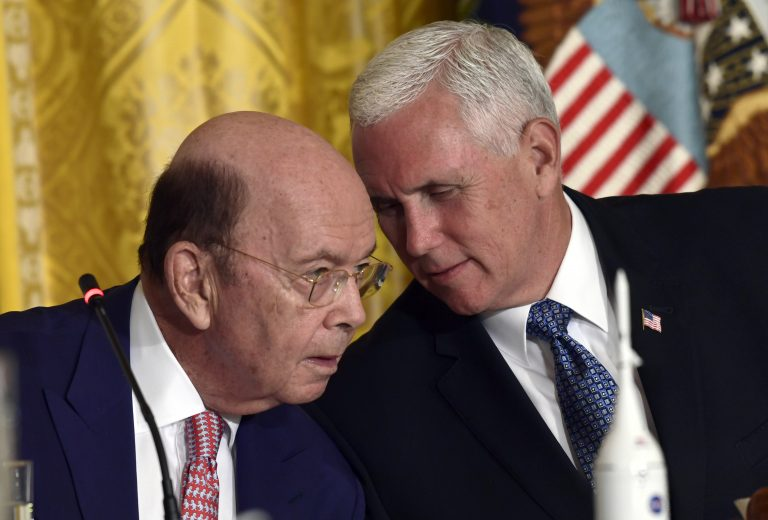 Vice President Mike Pence, right, leans over to talk to Commerce Secretary Wilbur Ross, left, during a National Space Council meeting in the East Room of the White House in Washington, Monday, June 18, 2018. (AP Photo/Susan Walsh)