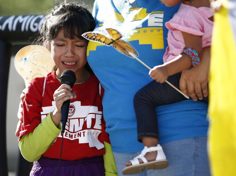 Akemi Vargas, 8, cries as she talks about being separated from her father