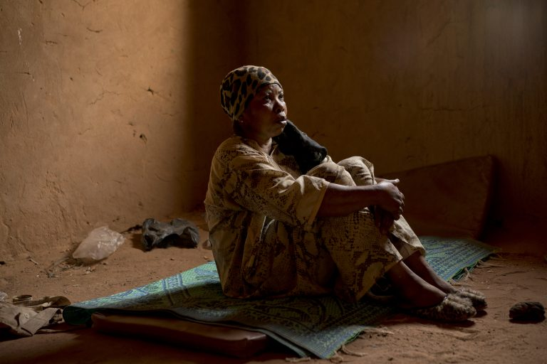Janet Kamara, from Liberia, sits during an interview conducted in an International Organization for Migration transit center in Arlit, Niger on Saturday, June 2, 2018. Kamara was expelled from Algeria, and left stranded in the Sahara while pregnant.