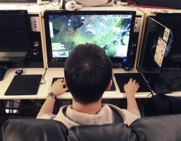 In this Wednesday, Dec. 11, 2013 file photo, a college student plays a computer game at an Internet cafe in Seoul, South Korea. On Monday, June 18, 2018, the World Health Organization said that compulsively playing video games now qualifies as a mental health condition. (Ahn Young-Joon/AP Photo)