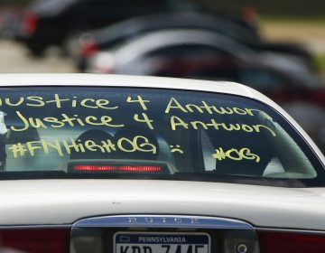 One of the vehicles in the funeral procession for Antwon Rose Jr. has a message displayed as it arrives at the Woodland Hills Intermediate school on Monday, June 25, 2018, in Swissvale, Pa. Rose was fatally shot by a police officer seconds after he fled a traffic stop June 19, in the suburb of East Pittsburgh. (AP Photo/Keith Srakocic)