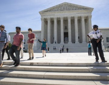 Visitors depart the Supreme Court early Monday, June 25, 2018. The justices upheld the Trump administration's travel ban on Tuesday. (AP Photo/J. Scott Applewhite)