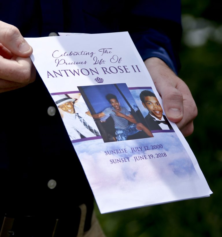 Kyle Fogarty shows the program for the funeral for Antwon Rose Jr. on Monday, June 25, 2018, in Swissvale, Pa. Rose was fatally shot by a police officer seconds after he fled a traffic stop June 19, in the suburb of East Pittsburgh. Fogarty said he was a classmate of Rose and had to attend the service. (Keith Srakocic/AP Photo)