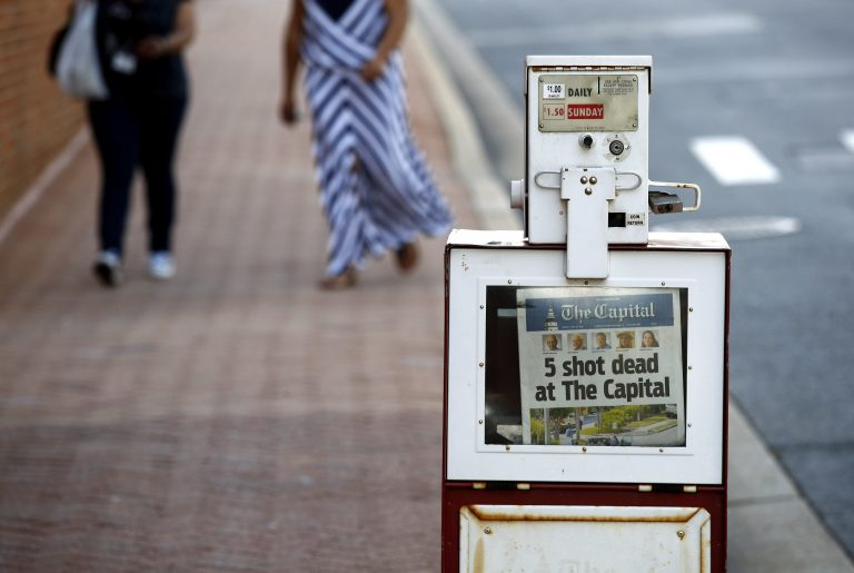 A Capital Gazette newspaper rack displays the day's front page, Friday, June 29, 2018, in Annapolis, Md. A man armed with smoke grenades and a shotgun attacked journalists in the newspaper's building Thursday, killing several people before police quickly stormed the building and arrested him, police and witnesses said. (Patrick Semansky/AP Photo)