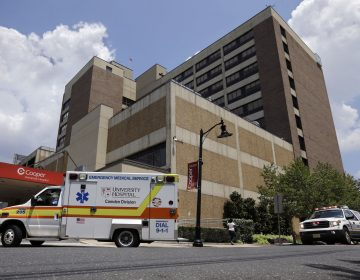 University Hospital, Camden Division, ambulances and emergency trucks rush to the emergency room at Cooper University Hospital Tuesday, July 7, 2015, in Camden, N.J. (Mel Evans/AP Photo)