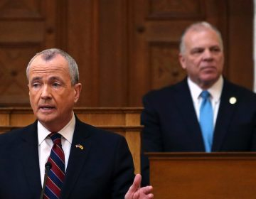 In this March 13, 2018 file photo, Senate President Steve Sweeney, (right), D-West Deptford, N.J., listen as New Jersey Gov. Phil Murphy, (left), addresses a gathering as he unveils his 2019 budget  in the Assembly chamber of the Statehouse in Trenton, N.J. Murphy and  Sweeney are both Democrats, but their disagreements revealed trouble early on among two key figures responsible for enacting New Jersey's roughly $37 billion budget. (Mel Evans/AP Photo, File)