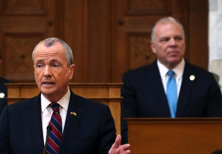 Senate President Steve Sweeney, (right), D-Gloucester, listens as New Jersey Gov. Phil Murphy speaks in the Assembly chamber of the Statehouse in Trenton. (Mel Evans/AP Photo, File)