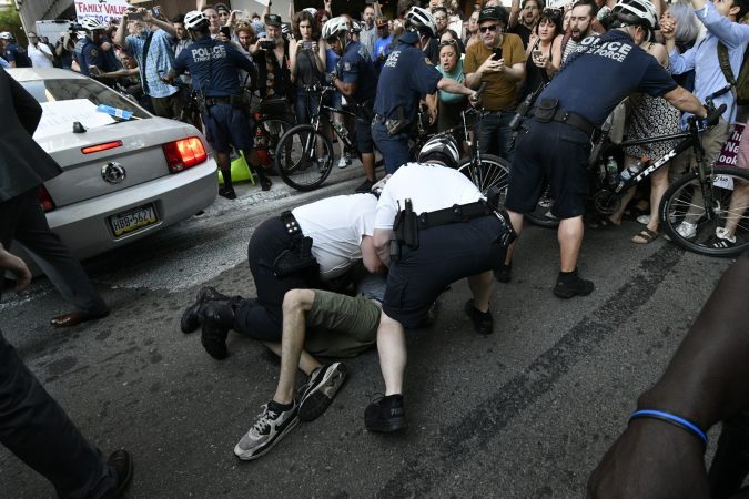 Police cleared the path as a government vehicle navigates through the crowd near Walnut and 19th streets. (Bastiaan Slabbers for WHYY)